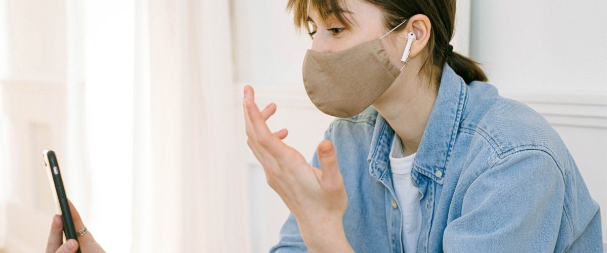 woman-with-a-face-mask-having-a-video-call-4240578